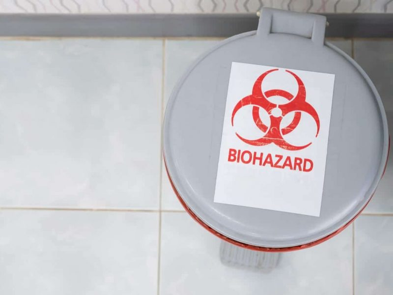 Biohazardous containers used to safely remove sharps, needles, and IV catheters that contain any human blood.