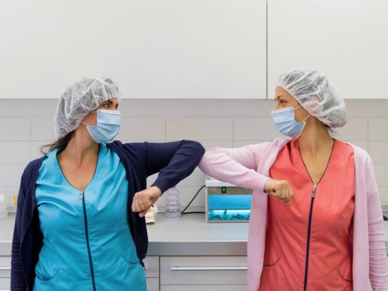 two-young-medical-workers-practicing-social-distancing-greeting-with-elbows-elbow-greeting-mask-masks_t20_WgPLaz