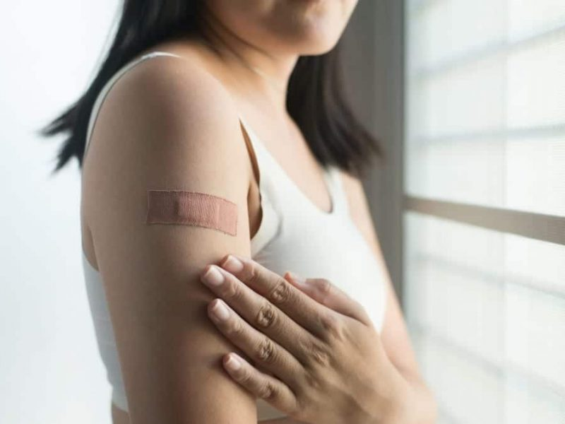 woman-using-adhesive-bandage-plaster-on-her-arm-after-injection-vaccine_t20_6YAoV2