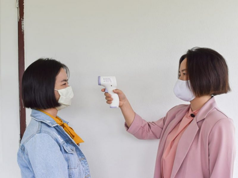 women-hand-holding-infrared-forehead-thermometer-to-check-body-temperature-concept-of-protect-from_t20_G0bWYY