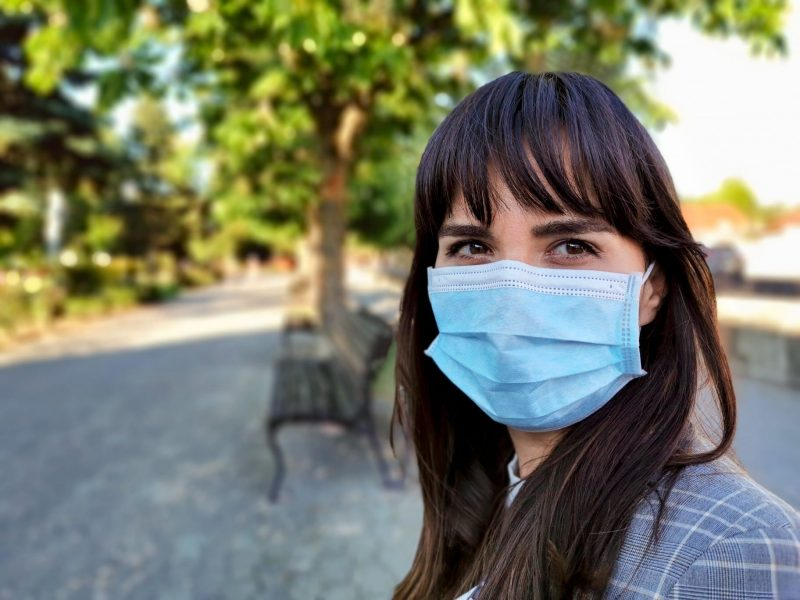 young-woman-in-city-wearing-protective-face-mask-virus-covid-19-corona-virus-one-person-portrait_t20_YEg6KX